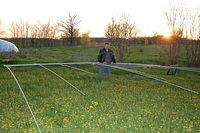 Here is Brent,N9BC again holding up my Bencher Skyhawk.This antenna covers 10,15 and 20 meters.It is now on top of one of my tow